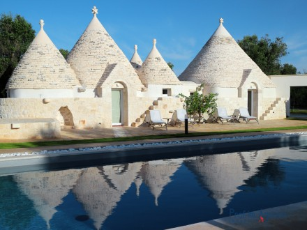 Fascinating complex of trulli with swimming pool